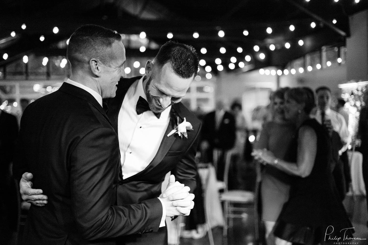 Wedding Scene with two men in forefront